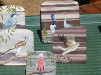 birds painted on zebra rocks