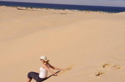 Jane rides the sandboard