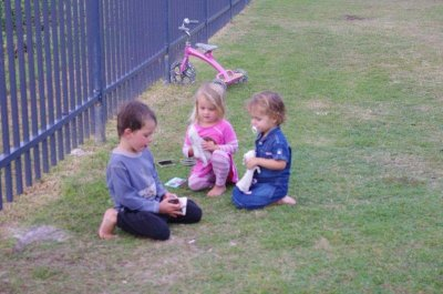 Oliver, Alana and Nadia take some time out from riding Nadia's bike