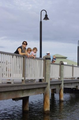 Michelle, Nadia, Tia, Greg and Isaac feed the fish at Twin Waters