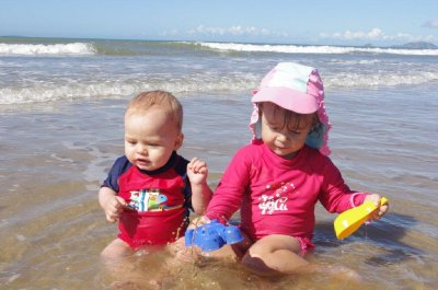 Nadia and Isaac playing in the shallows at Farmborough Beach
