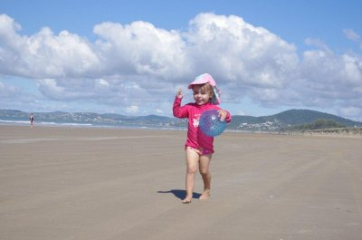 Nadia fetches the ball on Farmborough Beach, Yeppoon