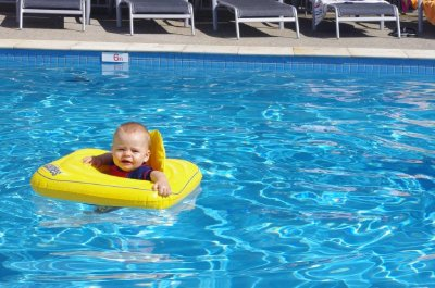 Isaac floating in the pool