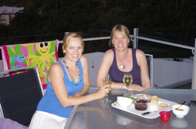 Jane and Karen enjoy a drink on the balcony