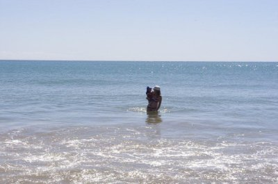 Nadia and Isaac take a swim in the beautiful water of Radical Bay