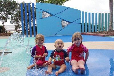 Nadia, Isaac and Chante get wet at Muddy's Playground