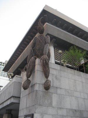 fun wooden sculpture atop a building