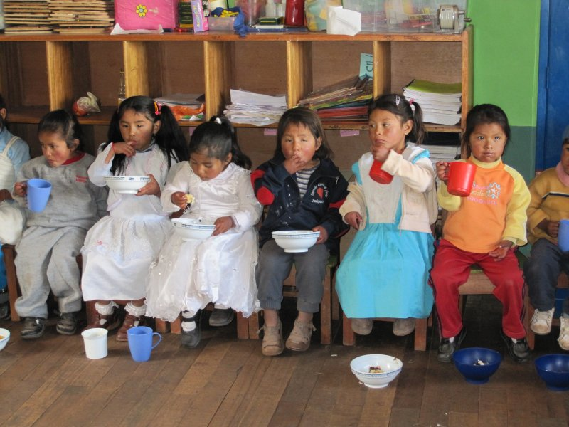 kindergarten children eating their cake very patiently!
