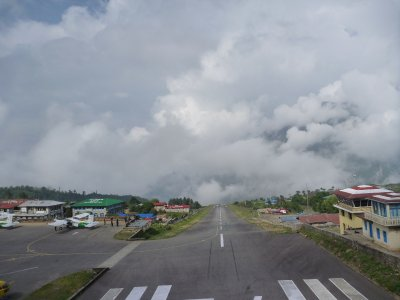 Lukla airport runway (most dangerous!). Yes, that is a cliff it goes off of (and behind the clouds are 2 big mountain!)