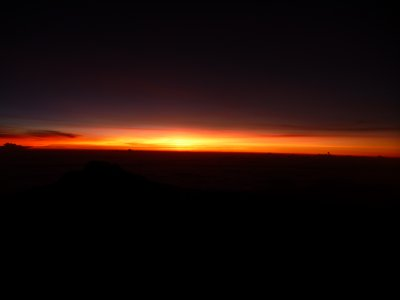 Sun Rising over the clouds on top of Kilimanjaro