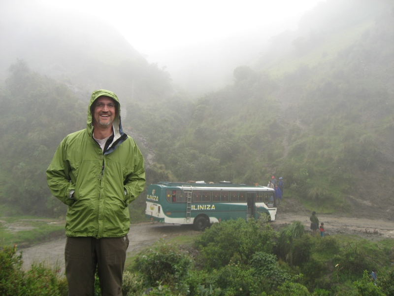 Chugchilán - Tim looking bemused as the bus sits, stuck in the road.