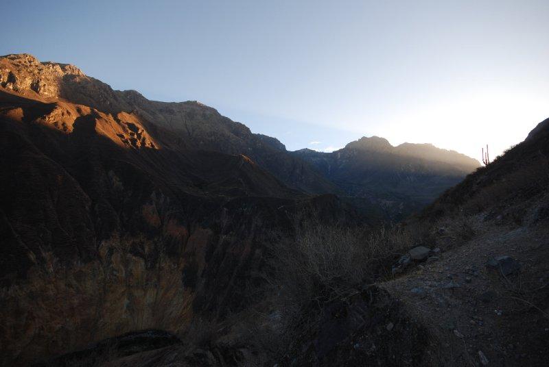 Dawn light hits the canyon wall