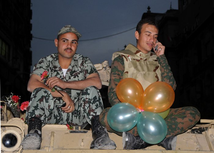 Soldiers with balloons and flowers