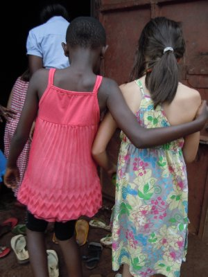Mara and her friend, Dianna, enter a neighbour's home, arm in arm