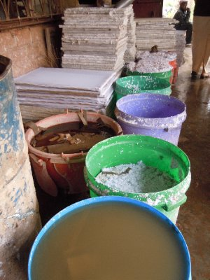Paper pulp soaks in big buckets