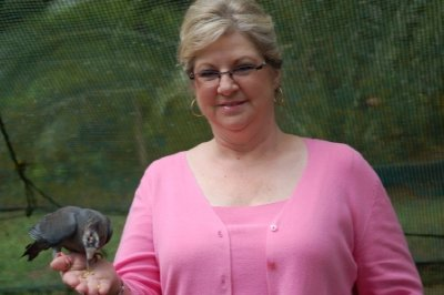 Cindy feeding a bird.