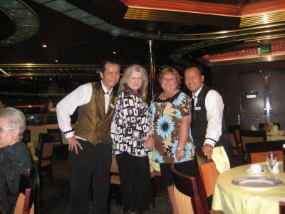 Cindy and I with our awesome waiters.