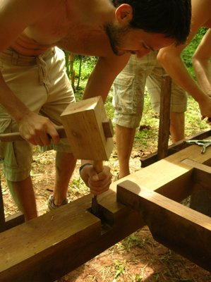 some last minute adjustments as we put the floor joists together
