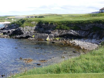 Tee shot over the ocean to the 18th green