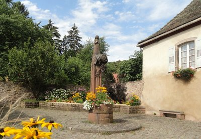Centuries old statue of St Richarde and her bear adorn a town well