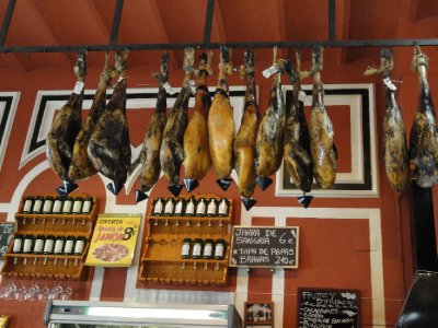 Cured hams for tapas hanging in cafe