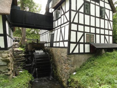 The waterwheel which powers the mill.