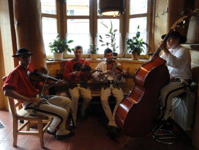 A group of young men playing traditional Polish music