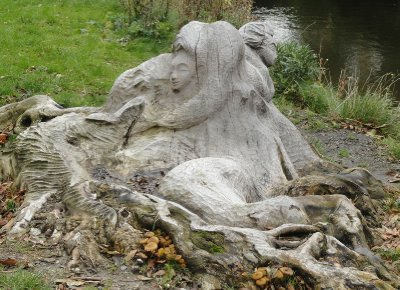 Sculpture carved from old tree - by the canal