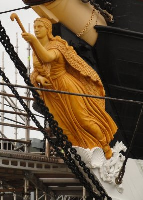 The Figurehead -'Ran', the goddess of the sea and wife of the sea god Aegir in Nordic mythology.  Ran would catch dead sailors in her net which is wrapped around her body.  This provided a sense of safety for the crew as only a few of them could swim.