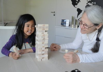 Playing Jenga ..  she's good!