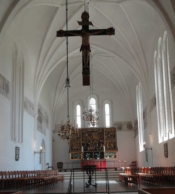 The simple decoration of The Church of Our Lady, looking towards altarpiece.   Note the lovely frescoes on the walls.