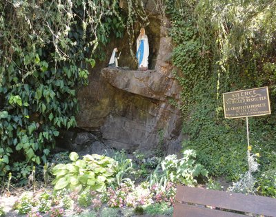 A grotto to 'Our Lady' beside a path in the village