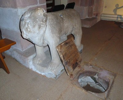 The stone bear guarding the trapdoor in the floor of the crypt church marking the spot where the bear scratched the earth