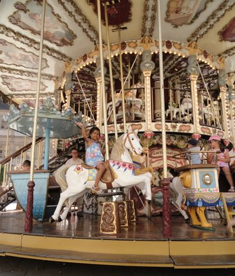 Enjoying a ride on this lovely carousel