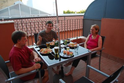 Enjoying dinner on our penthouse apartment balcony
