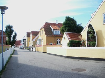 Skagen14   Adding a holiday atmosphere to Skagen many of the houses are painted alike with pure white trim, brilliant yellow walls and red tile roofs.   Very pretty