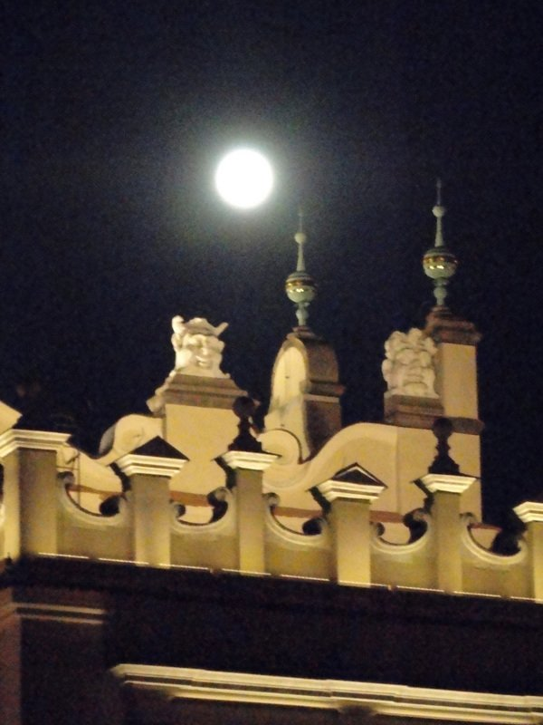 Full moon rising over The Cloth Hall