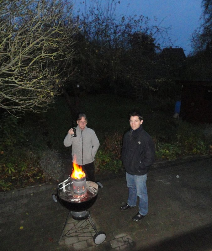 Chas and Aaron preparing the grill to cook the ducks for dinner