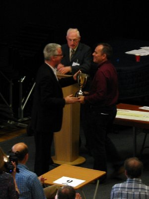 Sir Peter Stothard presents Mark Goodliffe with the Championship cup