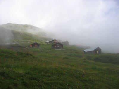 huts in a cloud