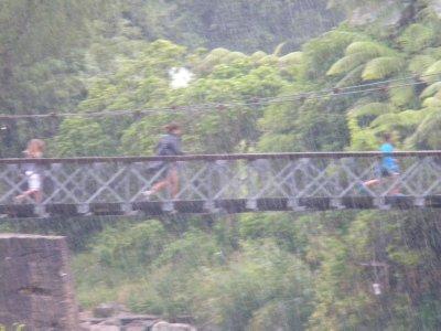 Running Across Hanging Bridge in Rain