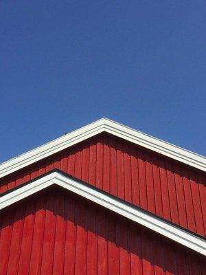Blue sky, red building... typical Norwegian roofline