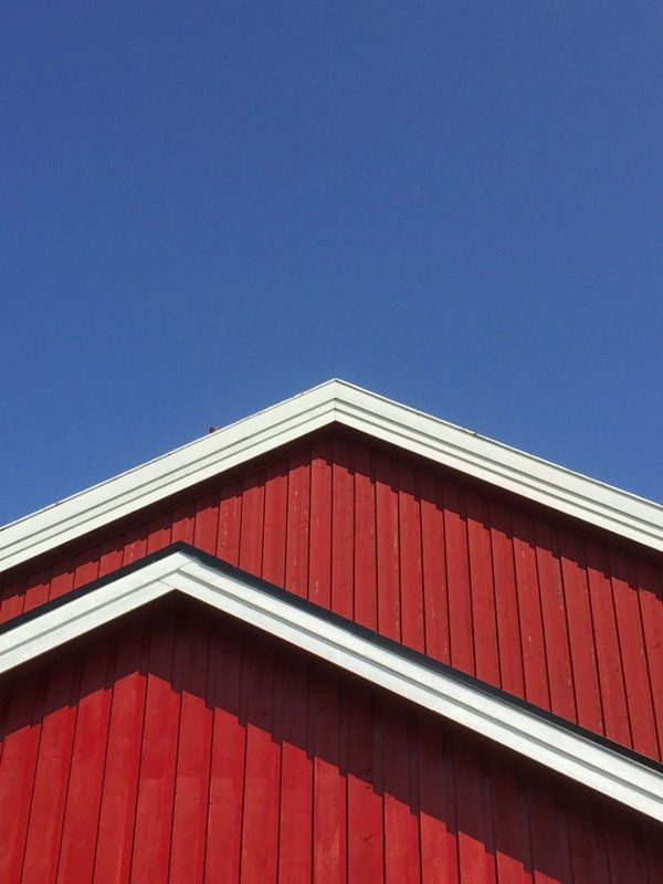 Blue sky, red building... typical Norwegian roofline