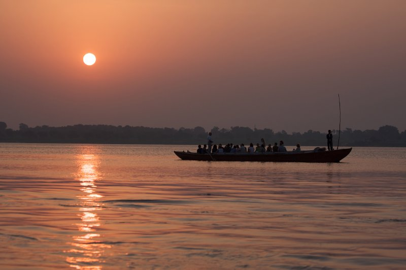 Boat on the Ganges near the ghats at sunrise, Varanasi, India