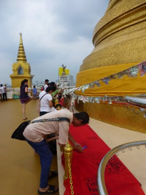 Writing Prayers at the top of Wat Saket Golden Mountain Temple