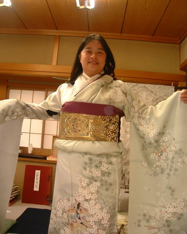 Trying Japanese tradition-wearing Kimono