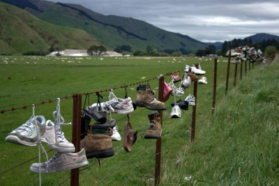 Shoes Hangin' on Fence. Photo by ontarions
