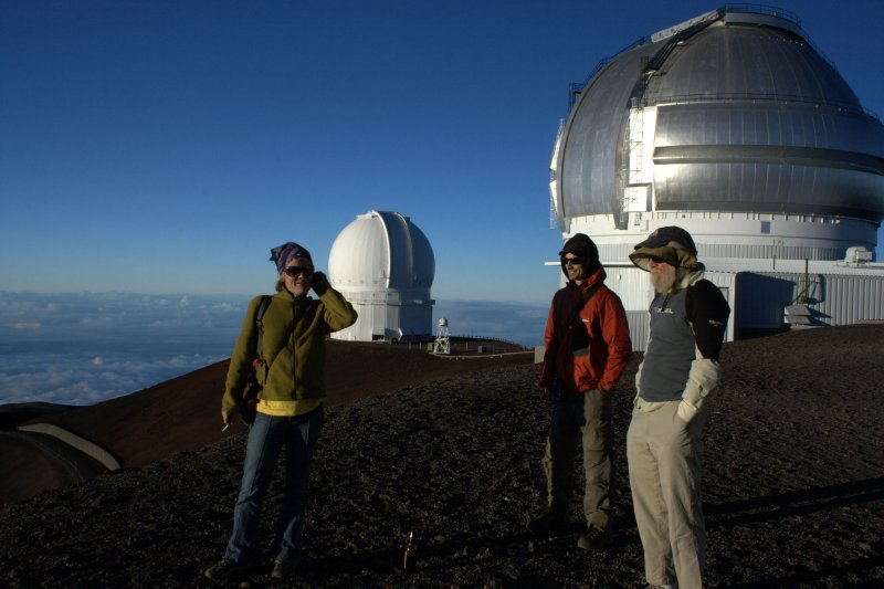 Melanie, Nate & Jonathan infront of telescopes
