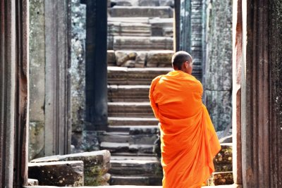 A robed monk ponders Angkor Thom