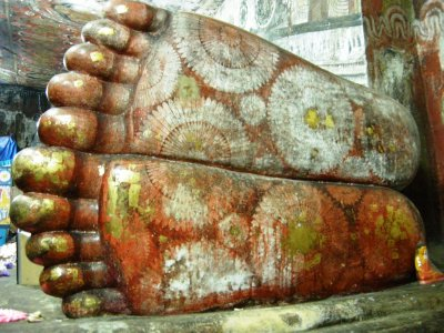The colourful feet of the reclining Buddha at the Cave Temple in Dambulla